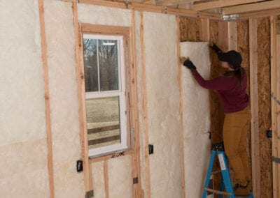Austin Company | installing fiberglass in walls of home
